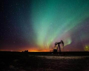 aurora borealis over a pumpjack